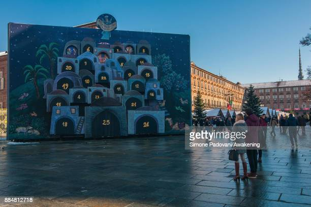 People look at the Advent Calendar in Castello square for the Christmas Markets on December 3 2017 in Turin Italy