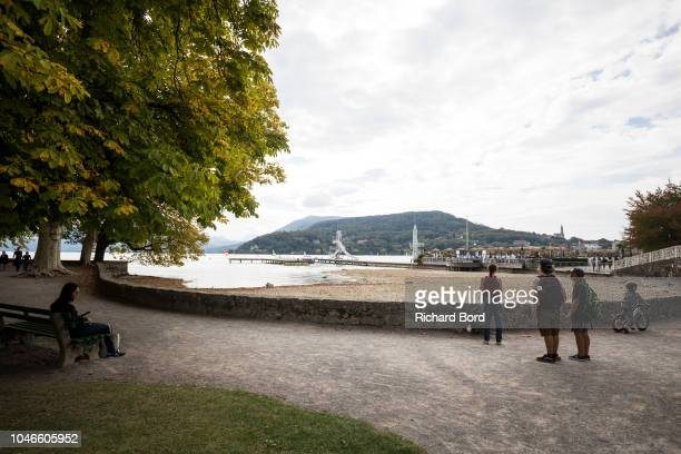 People look at the Annecy Lake on October 6 2018 in Annecy France Lake Annecy has reached a low level due to this past summer's heatwave