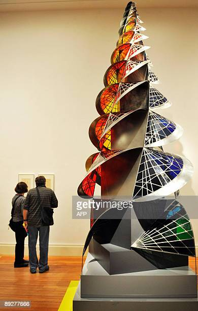 People look at the art works on display next to Swiss artist Johannes Itten's 'Tower of Fire' at the 'Bauhaus A Conceptual Model' exhibition in...
