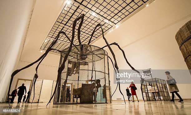 People look at the artwork 'Spider' at the 'Louise Bourgeois Strukturen des Daseins Die Zellen' exhibition preview at Haus der Kunst on February 26...