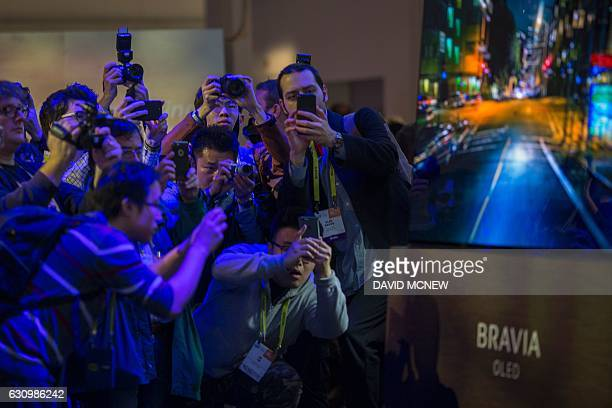 People look at the Bravia OLED television at the Sony Press Conference at the Sony Press Conference at CES at the 2017 Consumer Electronics Show in...