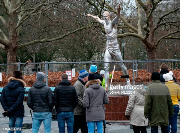 People look at the bronze statue of iconic football player Zlatan Ibrahimovic after it was vandalised on December 22 2019 in Malmo Sweden In Malmo...