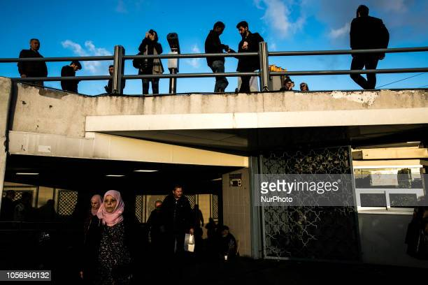 People look at the city from the Galata bridge in Karakoy Istanbul on