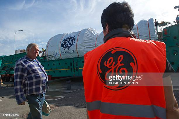 People look at the convoy carrying the most powerful turbine produced by General Electric which will reach the new gas power plant of Bouchain...