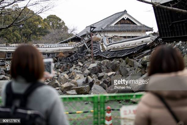 People look at the damage at Kumamoto Castle on January 14 2018 in Kumamoto Japan Kumamoto Castle was destroyed by the earthquake on April 142016