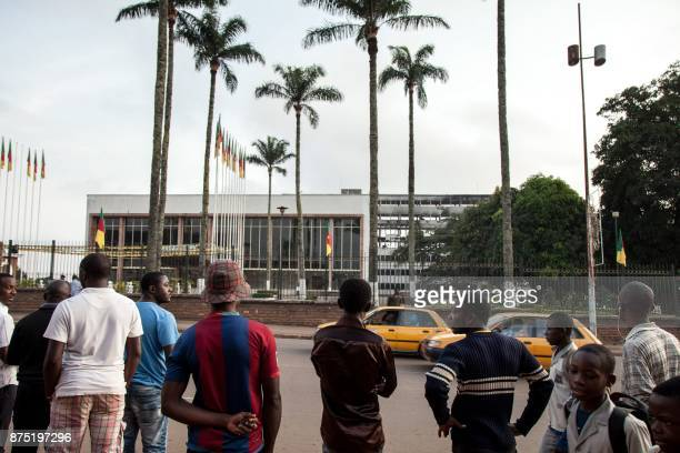 People look at the damaged building of Cameroon's parliament on November 17 2017 in Yaounde after a fire swept through the main building overnight...