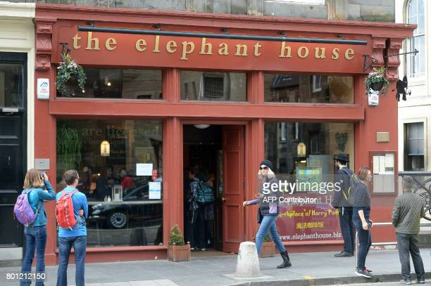 People look at the Elephant House cafe in Edinburgh, Scotland on June 26 cited with being the location where author J.K. Rowling started writing the...