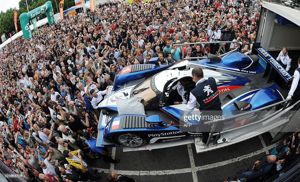 People look at the last year Le Mans 24-hour winning car, the Peugeot 908 HDi FAP, on June 6, 2010 in Le Mans, western France. Fifty-six cars with 168 drivers will participate on June 12 and 13 in the 78th edition of the Le 24-hour endurance race.