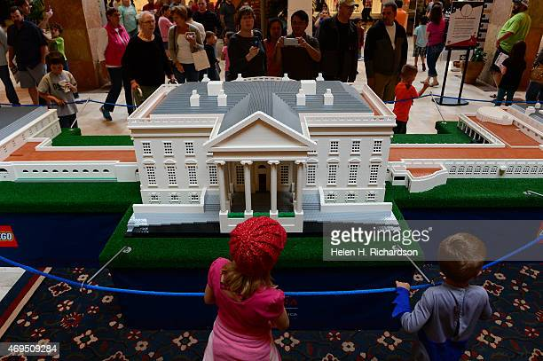 People look at the Lego White House that is part of the Lego Americana Roadshow at Park Meadows Mall in Lone Tree Colorado on April 12 2015 ll The...