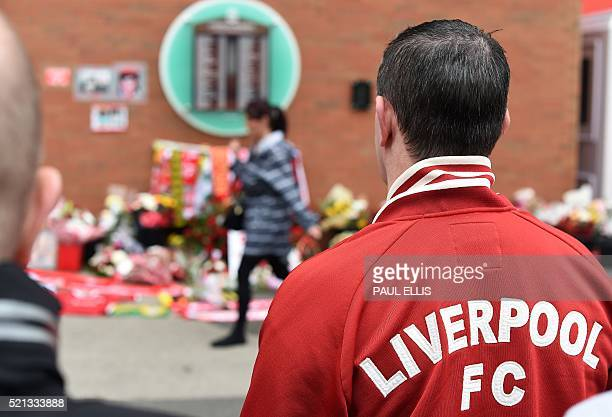 People look at the list of victims' names at the temporary Hillsborough memorial ahead of a memorial service at Anfield in Liverpool north west...