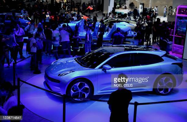 People look at the Lynk & Co Zero concept car displayed at the Beijing Auto Show in Beijing on September 26, 2020.