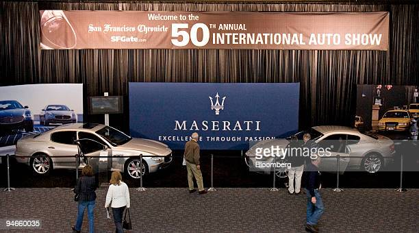 People look at the Maserati Quattroporte left and Gran Turismo models at the entrance of 50th Annual International Auto Show in San Francisco...
