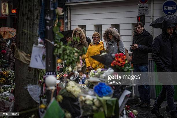 People look at the memorial in quotLa Belle Equipequot restaurant in the 11th district of Paris on November 21 2015 following a series of coordinated...