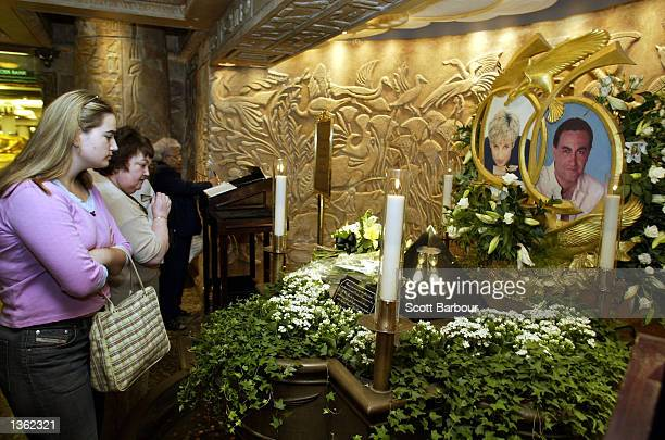 People look at the memorial to Diana Princess of Wales and Dodi Al Fayed in Harrods department store August 31 2002 in London England Princess Diana...