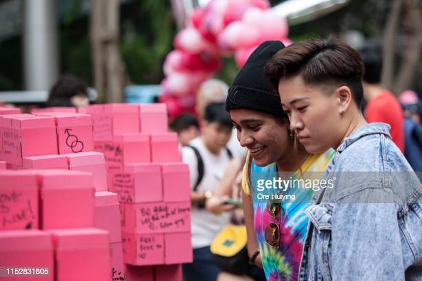 People look at the message of hope board during the Pink Dot event held at the Speaker's Corner in Hong Lim Park on June 29 2019 in Singapore