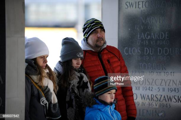 People look at the monument for the Uknown Soldier on Pilsudski Square on March 17 2018