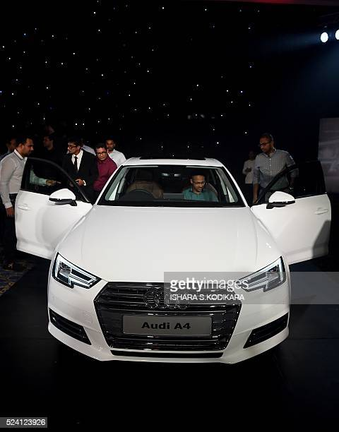 People look at the new Audi A4 during its launch in Colombo on April 25 2016 / AFP / ISHARA SKODIKARA