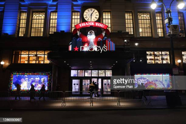 People look at the newly revealed Macy's Herald Square holiday windows on November 19 2020 in New York City This year's windows look to give thanks...