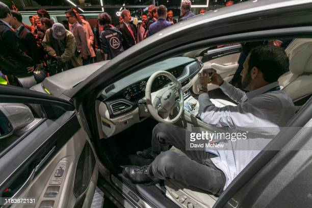 People look at the new-unveiled Genesis G90 at AutoMobility LA on November 20, 2019 in Los Angeles, California. The four-day press and trade event...