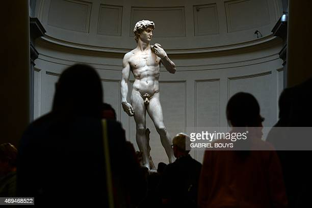 People look at the original 16th century statue of David by Italian artist Michelangelo Buonarroti in the Galleria dell'Accademia on April 9 2015 in...