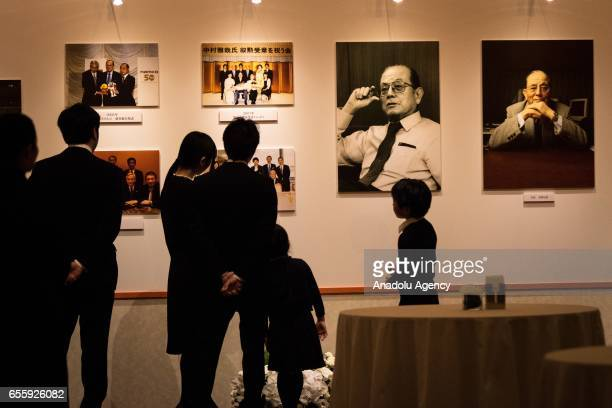 People look at the photographs of the businessman Masaya Nakamura the founder of video game company Bandai Namco and known as the 'father' of the...