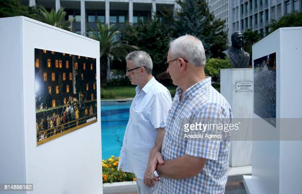 People look at the photos of photojournalists of Turkey's semiofficial news agency Anadolu Agency taken on 15th of July 2016 coup attempt during the...