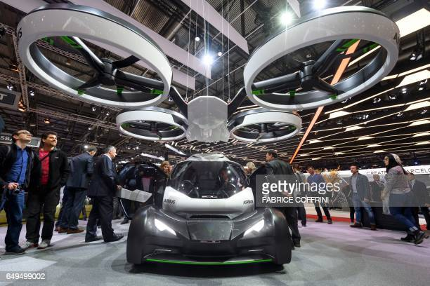People look at the PopUp concept a trailblazing modular ground and air passenger concept vehicle system by Italdesign and Airbus on the second press...