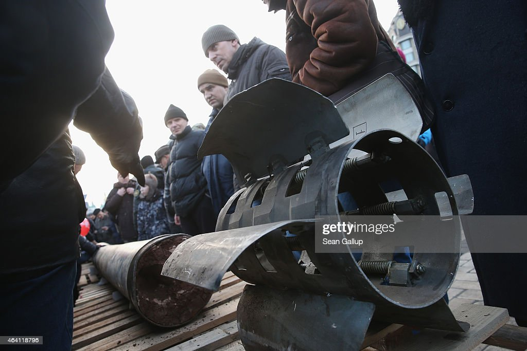 People look at the remains of a missile that is part of an exhibition of weapons, drones, documents and other materials the Ukrainian government claims it recovered in eastern Ukraine and prove direct Russian involvement in the fighting between Ukrainian troops and pro-Russian separatists on February 22, 2015 in Kiev, Ukraine. Russia has denied sending heavy weaponry to the separatists, admitting only that Russian volunteers are participating in the fighting.