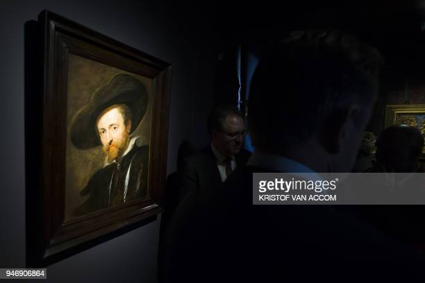 People look at the selfportrait of Flemish painter Rubens during the press presentation at the Ruben House in Antwerp after the painting was restored...