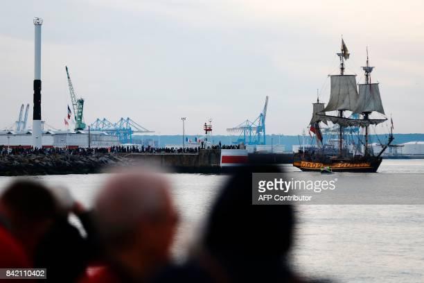 """People look at the """"Shtandart"""" sailing boat during """"Les Grandes Voiles du Havre"""" event on September 3, 2017 in Le Havre, northwestern France. / AFP..."""