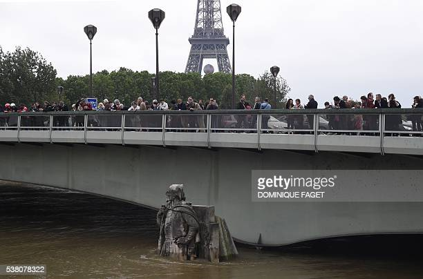 People look at the statue of the Zouave at the Alma bridge on June 4 as the River Seine's levels gradually recedes The rainswollen River Seine in...