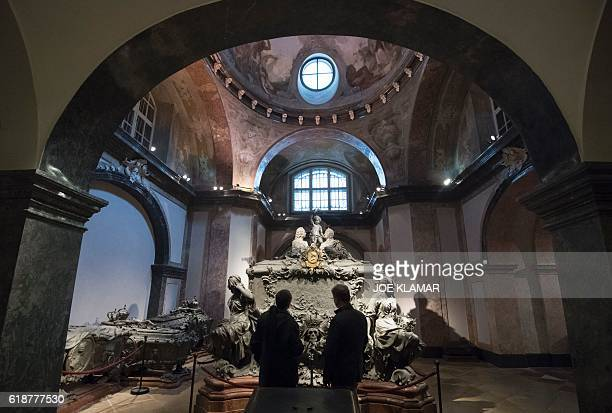 People look at the Tomb of Empress Maria Theresa of Austria one of 149 members of the Habsburg dynasty at the Imperial Crypt in Vienna, Austria on...