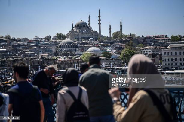 People look at the view from the Galata bridge on April 19 2018 in Istanbul President Recep Tayyip Erdogan on April 18 2018 called snap elections in...