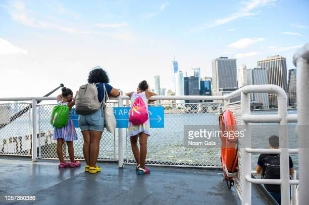 People look at the view from the Governors Island Ferry as the city enters Phase 4 of re-opening following restrictions imposed to slow the spread of...