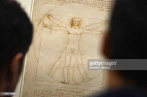 People look at the 'Vitruvian Man' a drawing by Leonardo da Vinci on August 2ç 2013 in Venice Fiftytwo drawings by Renaissance genius Leonardo da...