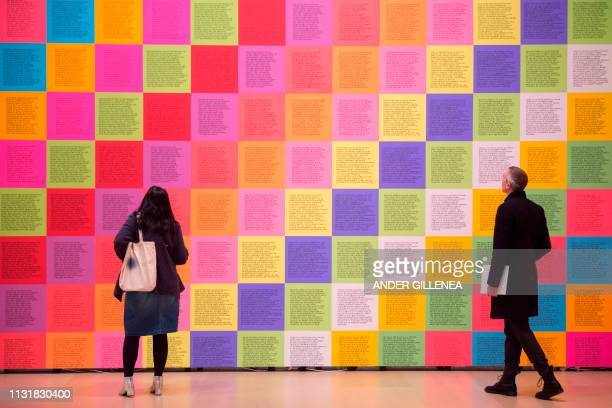 People look at US artist Jenny Holzer's 'Inflammatory Wall' during a presentation of the 'Jenny Holzer Thing Indescribable' exhibition at the...