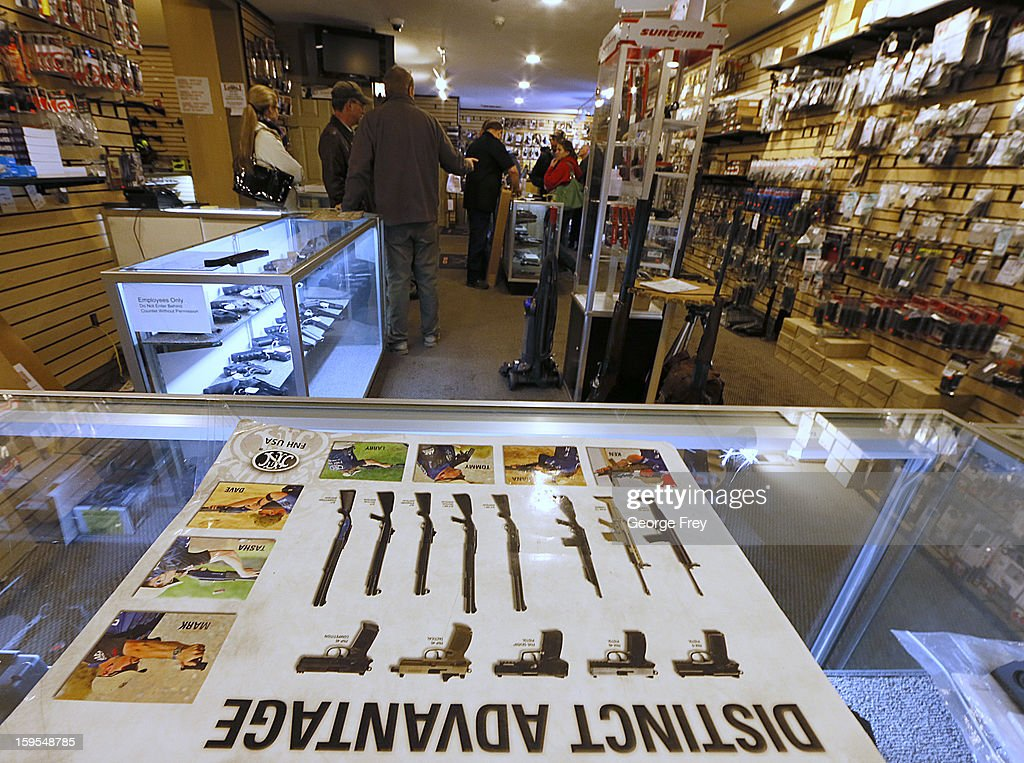 People look at various guns to purchase at the 'Get Some Guns & Ammo' shooting range on January 15, 2013 in Salt Lake City, Utah. Lawmakers are calling for tougher gun legislation after recent mass shootings at an Aurora, Colorado movie theater and at Sandy Hook Elementary School in Newtown, Connecticut.