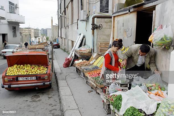 People look at vegetables at a shop in downtown Baku Azerbaijan on Saturday October 28 2006