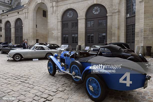 People look at vintage cars displayed on September 4 2015 in Chantilly prior to the Bonhams vintage cars auction sale on September 5 AFP PHOTO / ERIC...