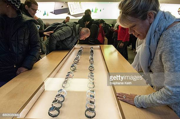 People look at watches at an Apple store on Fifth Ave on December 24 2016 in New York City Lastminute shoppers hit the stores the day before Christmas