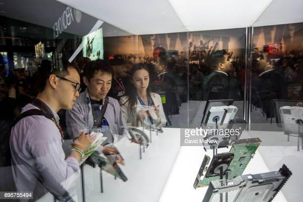 People look at X Box components on opening day of the Electronic Entertainment Expo at the Los Angeles Convention Center on June 13 2017 in Los...