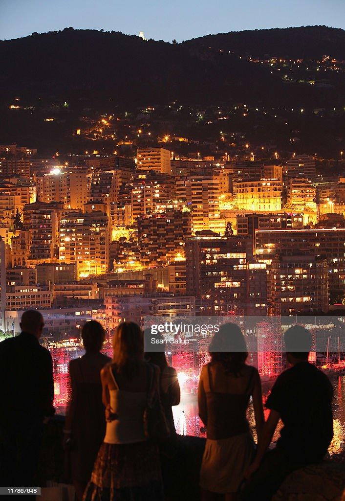 People look down at a lightshow below during the Jean Michel Jarre concert celebrating the wedding of Prince Albert II of Monaco to Charlene Wittstock at Port of Monaco on July 1, 2011 in Monaco, Monaco.