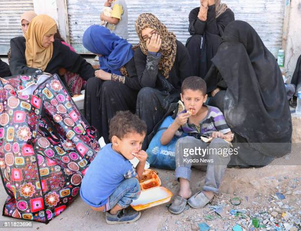 People look exhausted in the northern Iraqi city of Mosul on July 10 after escaping from an Islamic Statecontrolled area Iraqi Prime Minister Haider...
