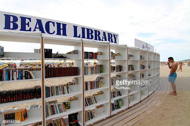 People look for and read books at the first ever free beach library opened in Bulgaria at the Black sea resort of Albena Sunday July 2014 In Albena...