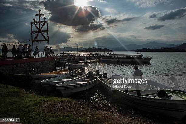 People look for boats to cross the Patzcuaro lake to reach the Janitzio Island during the celebration of the Day of the Dead in which people remember...