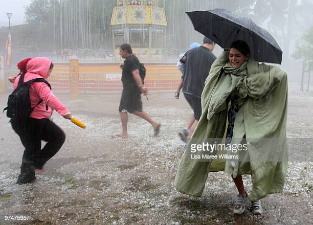 People look for cover from the hail storm on March 6, 2010 in Melbourne, Australia. A severe storm brought high winds, heavy rainfall, flash flooding...