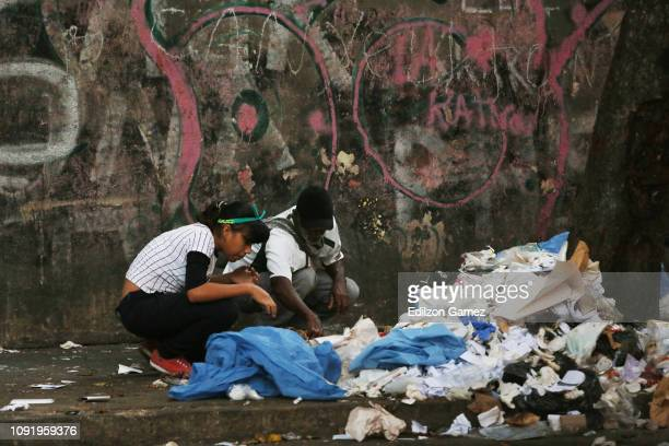 People look for food in the garbage due the extreme food shortages at Sabana Grande on January 31 2019 in Caracas Venezuela Today European Parliament...