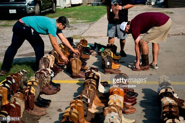 TOPSHOT People look for good deals on salvaged custom cowboy boots at Jesse's Shoe Repair as residents begin the recovery process from Hurricane...