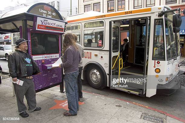 People look for information at the Yahoo interactive bus stop in the North Beach section of San Francisco. Yahoo has launched the world's first...