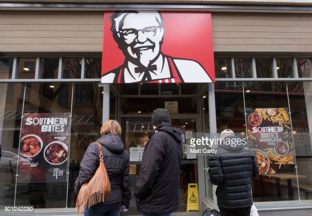 People look into a branch of KFC that is closed due to problems with the delivery of chicken on February 20 2018 in Bristol England KFC has been...